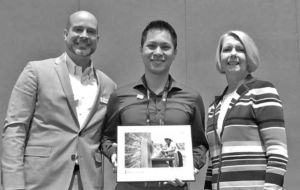 Patrick Hayes, Water For People Chief Development Officer (left), and Maureen A. Stapleton, Water for People Independent Director (right), present Gabriel Rodriguez, Water Resources Project Engineer at Bennett Engineering Services (left), with the Kenneth J. Miller Founders' Award 2018.